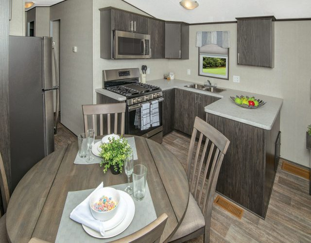 Northlander Reflection Park Model Cottage | Kitchen with Dining Table